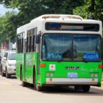 The typical green and white bus in Laos